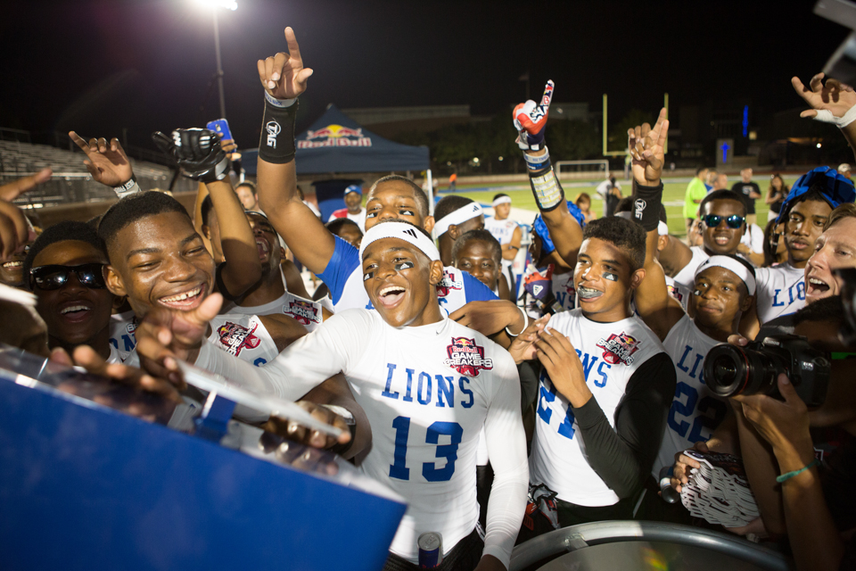 Dallas High School sports athletes reaching to the sky as they receive their trophy