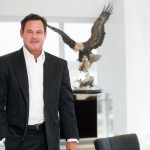 A corporate portrait in Dallas with a really cool eagle in the background