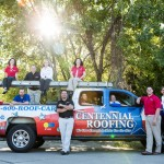 Another group portrait of a roofing company surrounding their truck.