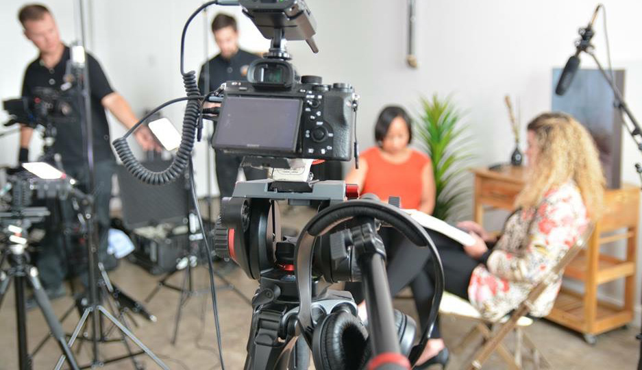 A behind the scenes look at a Dallas video interview with a Sony a7rII camera in the foreground.