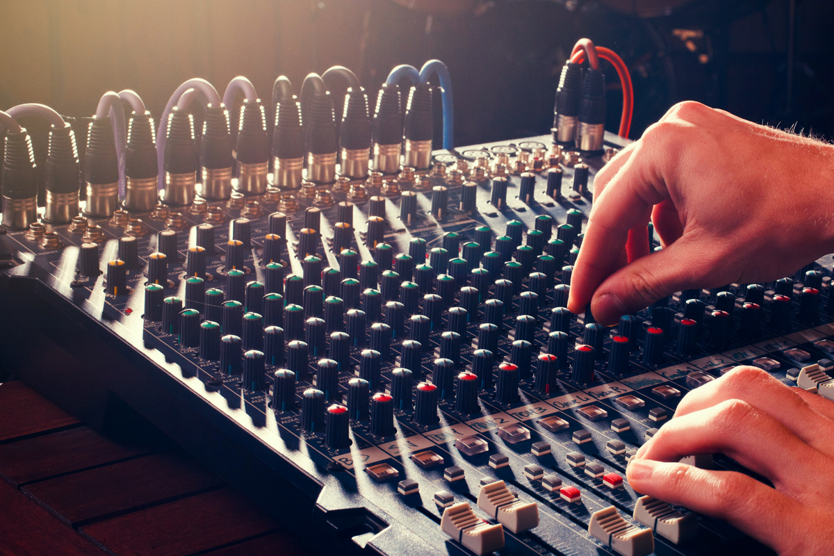 Live audio production, hands on a AV sound mixing board in Dallas.